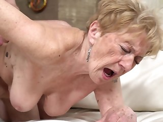 A horrific old granny is getting fucked at hand her pussy doggy style