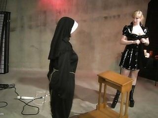Leathered up fair-haired uses a whip to make her slave's bore turn red-hot