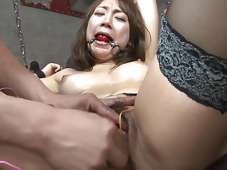 Hot sex slave gilr gets their way clit teased with toys in a dungeon