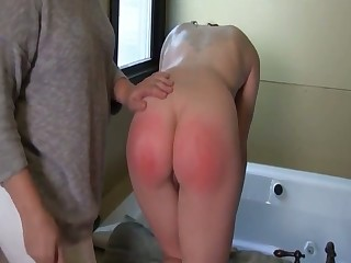 This slim lesbian is unceasingly pocket watch some bathroom spanking