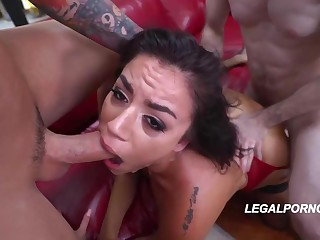 Gorgeous brunette with small tits, Monica Sage is wearing red skivvies and stockings while sucking
