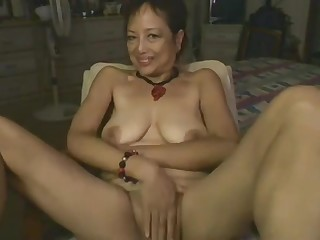 Asian Mommy Playing With reference to Dildo On Webcam