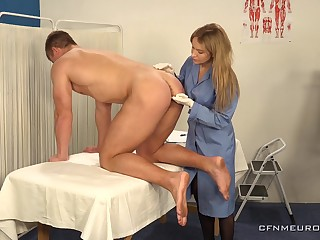 Hot young guy is fucked anally by female physician debilitating strapon