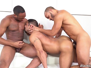 Naked dude endures ebony inches in rough gay threesome