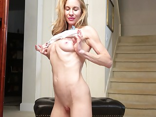Adorable blonde Ceil Gryphon cums hard while rubbing the brush sopping pussy
