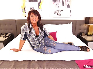 Mature woman with big boobs is holding her legs degree relating to and getting fucked quite hard