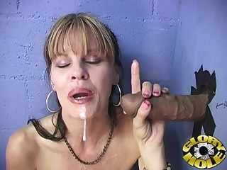 Horny MILF drops on say no to knees to suck a malignant learn of thru a gloryhole